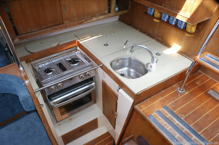 Nicholson 345 galley with ample storage