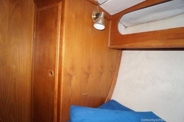 Freedom 35. wardrobe locker in bow cabin