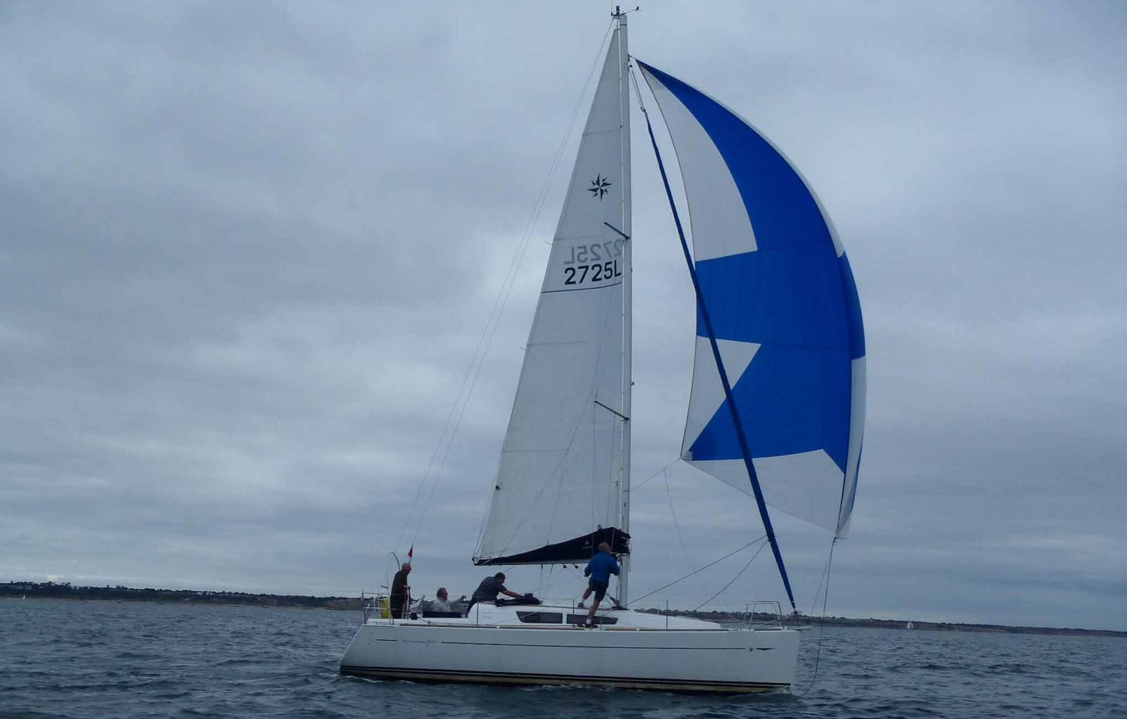 Sun Odyssey 331 with spinnaker