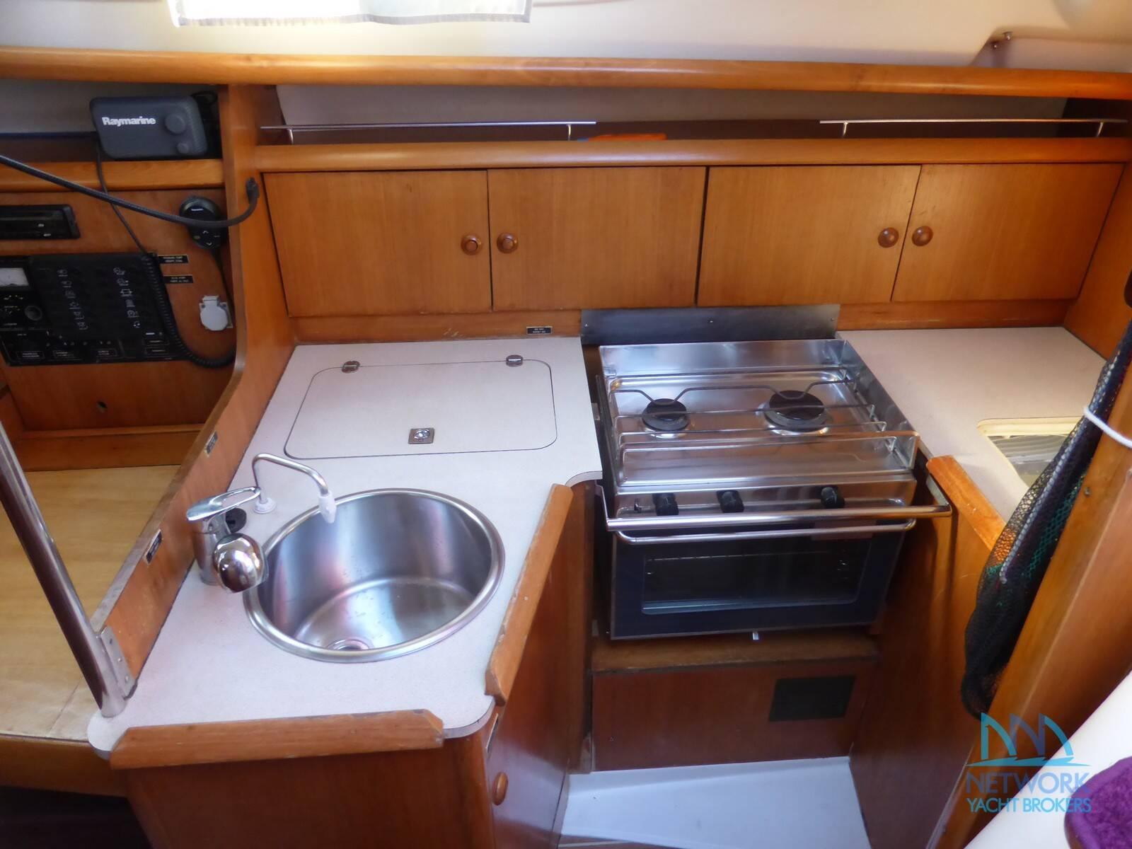 refrigerator, sink, gas oven