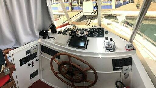 Tourist boat for sale helm